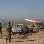 Suicide bombers, mortar fire in battle for Iraq village